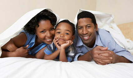 African family on the bed